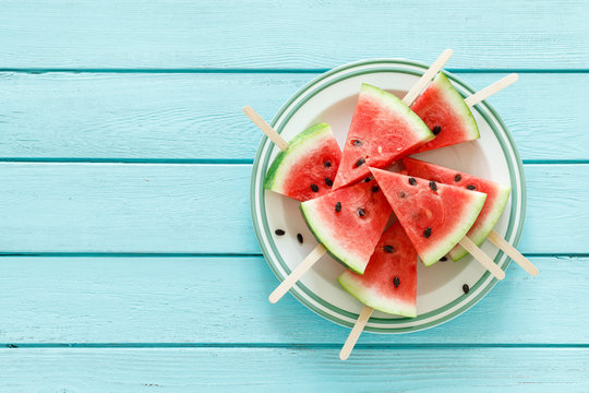 Watermelon slice popsicles, blank food background with space for a text, top view