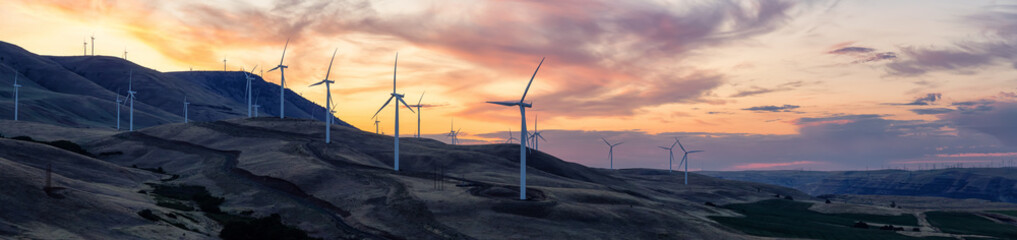 Beautiful Panoramic Landscape View of Wind Turbines on a Windy Hill during a colorful sunrise. Taken in Washington State, United States of America. Wall mural