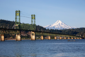 Beautiful View of Hood River Bridge going over Columbia River with Mt Hood in the background. Taken in White Salmon, Washington, USA.