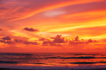 Wall Murals Coral Dramatic sunset sky over the tropical sea.