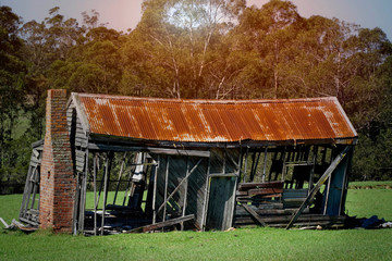 old derelict timber farm house abandoned in the countryside