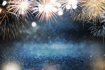 Fototapete - Gold and blue Fireworks and bokeh in New Year eve and copy space. Abstract background holiday.