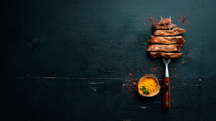 Printed roller blinds Steakhouse Pork steak on the fork. On a wooden background. Top view. Free space for your text.