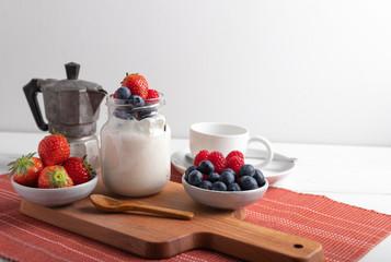 yogurt with fruit on a breakfast table