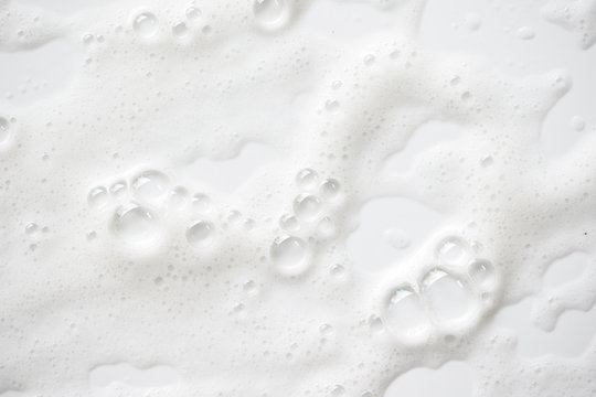 Abstract background white soapy foam texture. Shampoo foam with bubbles