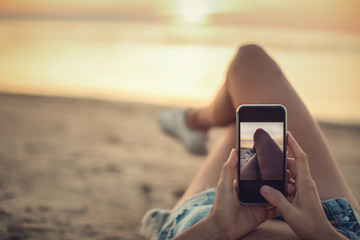 holiday woman taking video with smart phone