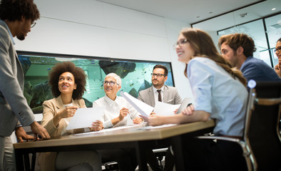 Wall Mural - Business colleagues having meeting in conference room in office