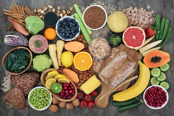 Acrylic Prints Food High fibre super food with whole grain bread loaf and rolls, fruit, vegetables, whole wheat pasta, cereals, seeds and nuts. Foods omega 3, anthocyanins, antioxidants and vitamins. Top view.