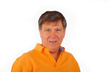 senior man with orange shirt looking positive
