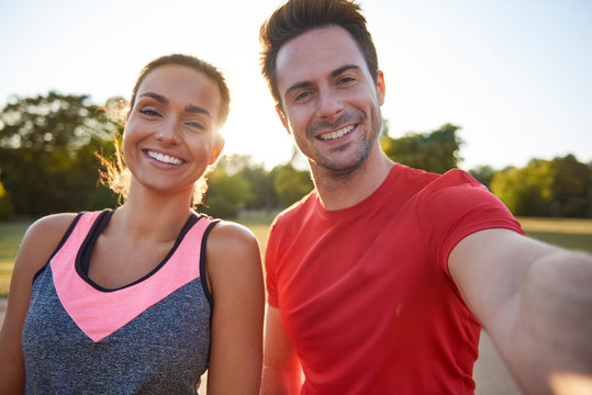 Selfie of young couple after workout on the fresh air