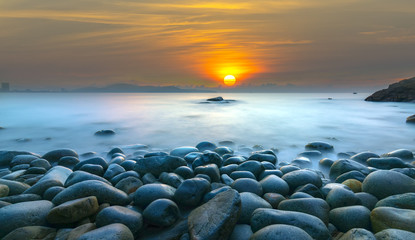 Beautiful Sunrise at rock like eggs beach in Quy Nhon bay, Vietnam Fototapete