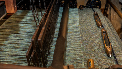 close up of an old traditional Scottish weaving loom for weaving Harris Tweed
