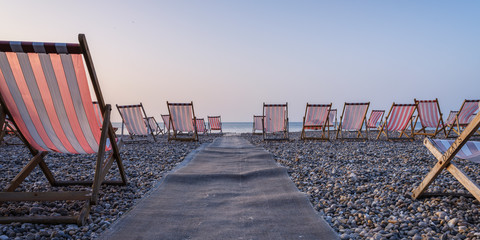 Deckchairs on the popular pebble beach at Beer near Seaton, Devon, England, United Kingdom, Europe