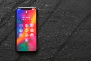 Riga, Latvia - March 25, 2018: iPhone X with locked screen.
