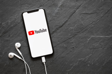 Riga, Latvia - March 25, 2018: iPhone X with YouTube logo on the screen.