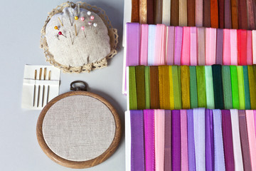 Accessories for embroidery with satin ribbons: hoop, needles with a big eyelet, pins and sets of multi-colored satin and nylon ribbons