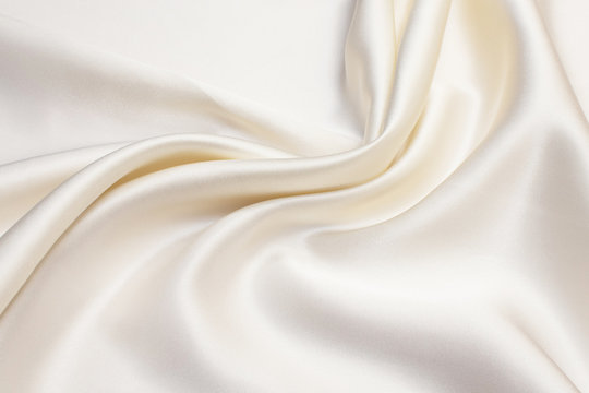 Texture of ivory silk fabric. Background, pattern.