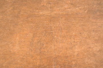 Scratched surface of an old wooden school desk