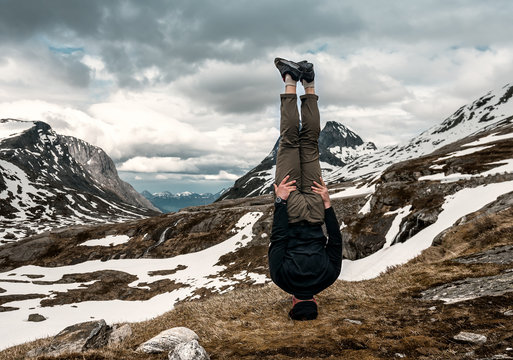 a man stands on his head tonned photo