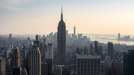 view of empire state building and downtown manhattan from the roof of the building, new york, america, usa