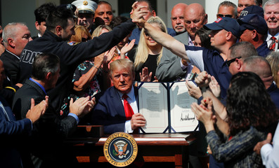 U.S. President Donald Trump participates in signing ceremony for September 11th Victim Compensation Fund Act at the White House in Washington