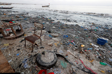 Plastic waste is seen at a fishermen port on the outskirts of Dakar