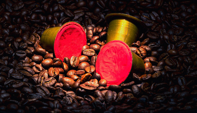 Coffee pods on beans