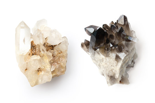 bright and dark healing crystals representing the eastern principle of yin and yang or opposites forming a unity, isolated design elements, top view / flat lay