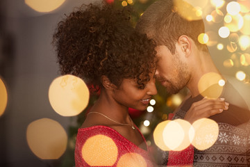 Loving couple embracing with warm lights