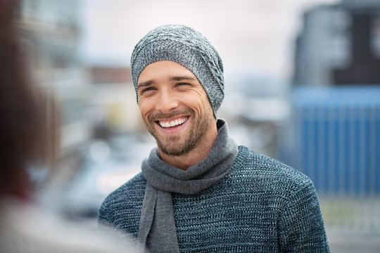 Smiling young man wearing winter clothes