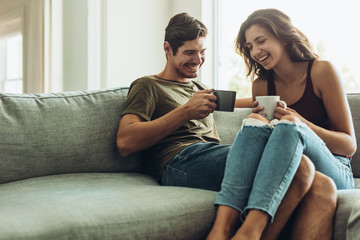 Couple relaxing at home with coffee