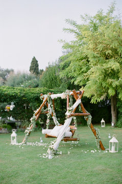 Outdoor swing draped in fabric and florals in Italy