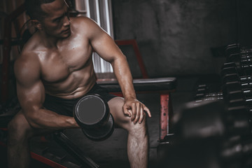Portrait of asian man big muscle at the gym,Thailand people,Workout for good healthy,Body weight training,Fitness at the gym concept,Prank to abdominal muscles,Lift up dumpbell Fototapete
