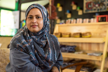 Muslim woman in a cafe