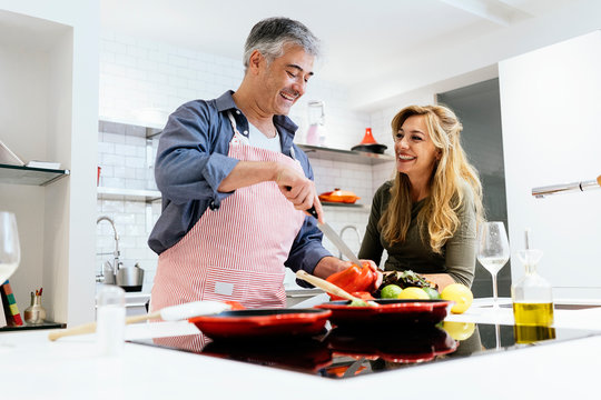 Married couple cooking together at home