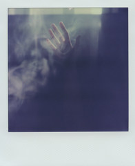 Crop hand in light and smoke