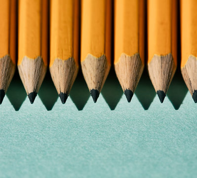Row Of Pencils On Blue Background
