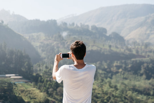 Man Taking A Photo Of Nature With His Phone