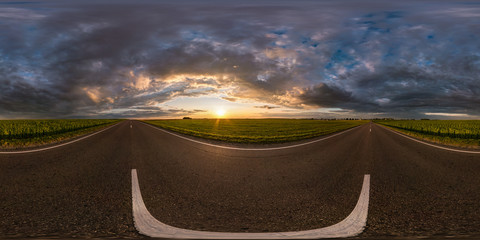 full spherical seamless hdri panorama 360 degrees angle view on asphalt road among fields in summer evening sunset with awesome clouds in equirectangular projection, for VR AR virtual reality content