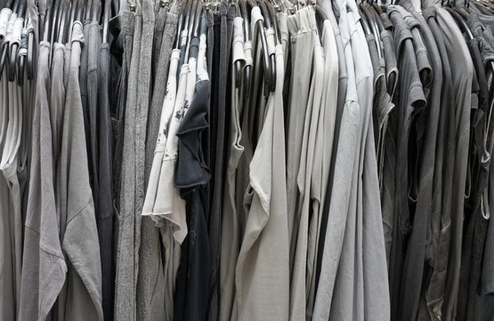 Twenty shades of grey and black clothing hanging on a rack