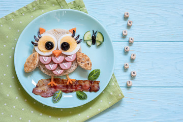 Cute little owl sandwich toast with sausages and eggs