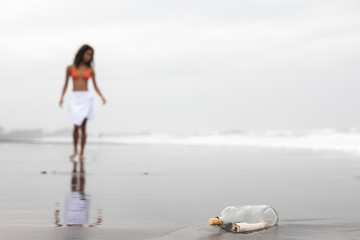Young woman finds message in a bottle