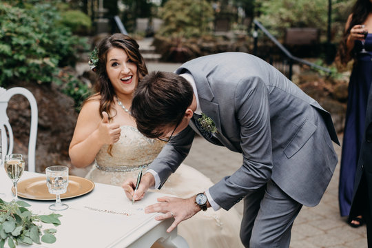 Groom Signing Marriage Certificate