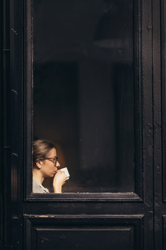 Side view of woman having coffee in cafe