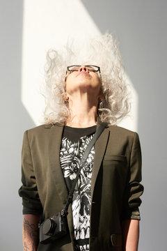Woman throwing hair