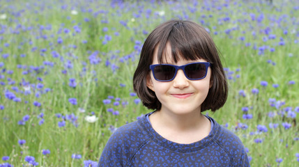 portrait of cheeky kid with sunglasses for joy and childhood