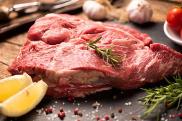 Raw fresh meat on a black cutting board