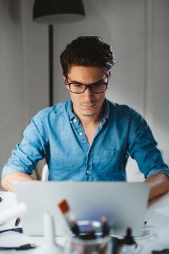 Man working on laptop in office