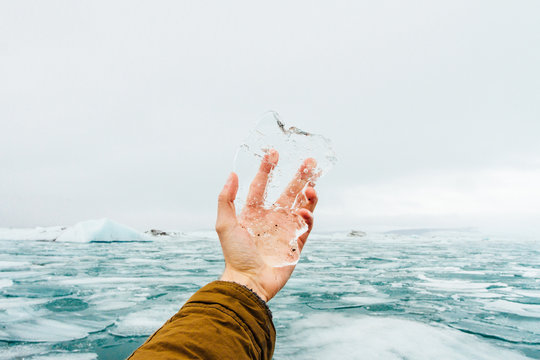 Close up of man's hand holding ice