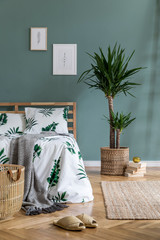 Boho style bedroom with basket and exotic plant - fototapety na wymiar